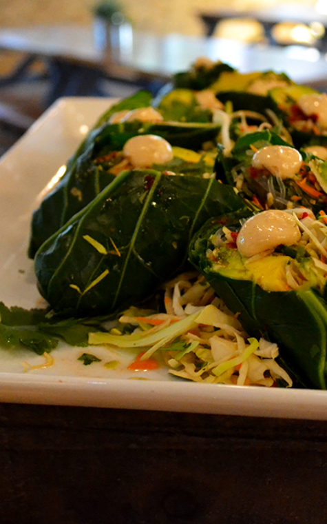 Collard green spring rolls are filled with carrot, avocado, cabbage and kelp noodles in a citrus vinaigrette.
